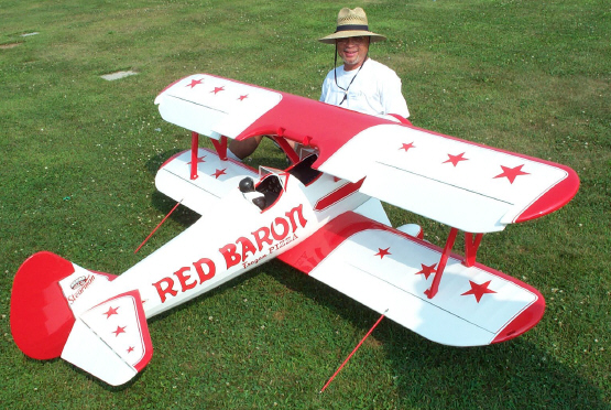 Joe Wilkins and his Red Baron. Hey Joe bring some pizza out to the field sometime.